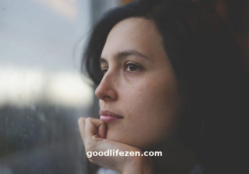 People-Pleaser - woman looking out of a window