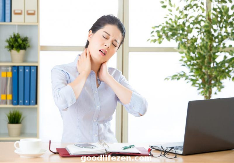 neck pain - woman holding neck
