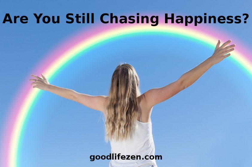 chasing happiness - woman and rainbow