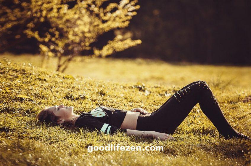 melt away stress - woman laying on grass