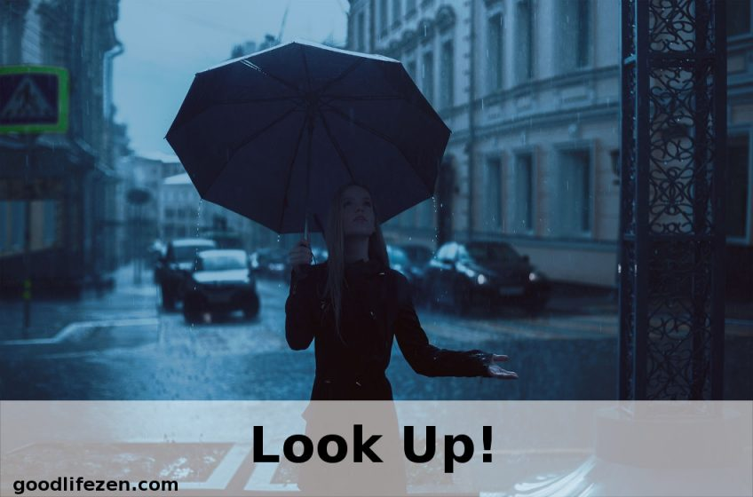 look up - woman with umbrella